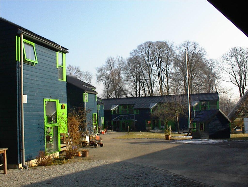 Træfacader og vinduer for andelsforening